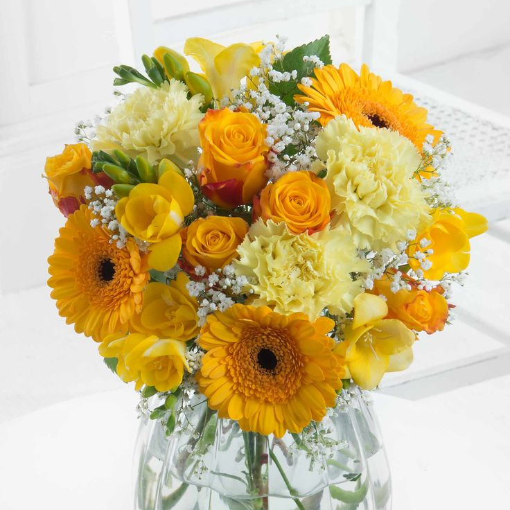 Golden Cheer - A warm and inviting bouquet that will bring the sunshine indoors at any time of year!