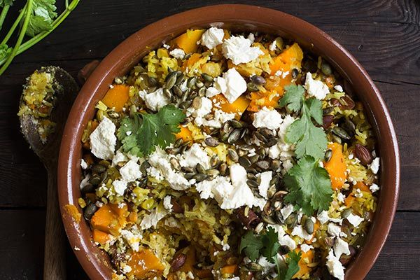 Pearl barley and rice pilaf with pumpkin, almonds and feta