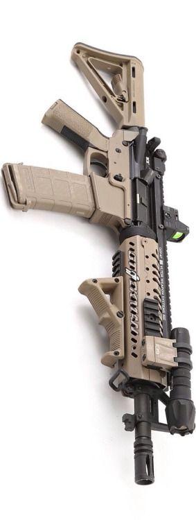 AR-15 Bravo Company USA Kino with Vltor rail, Elzetta light, Magpul furniture, and Rainier Arms Raptor CH.