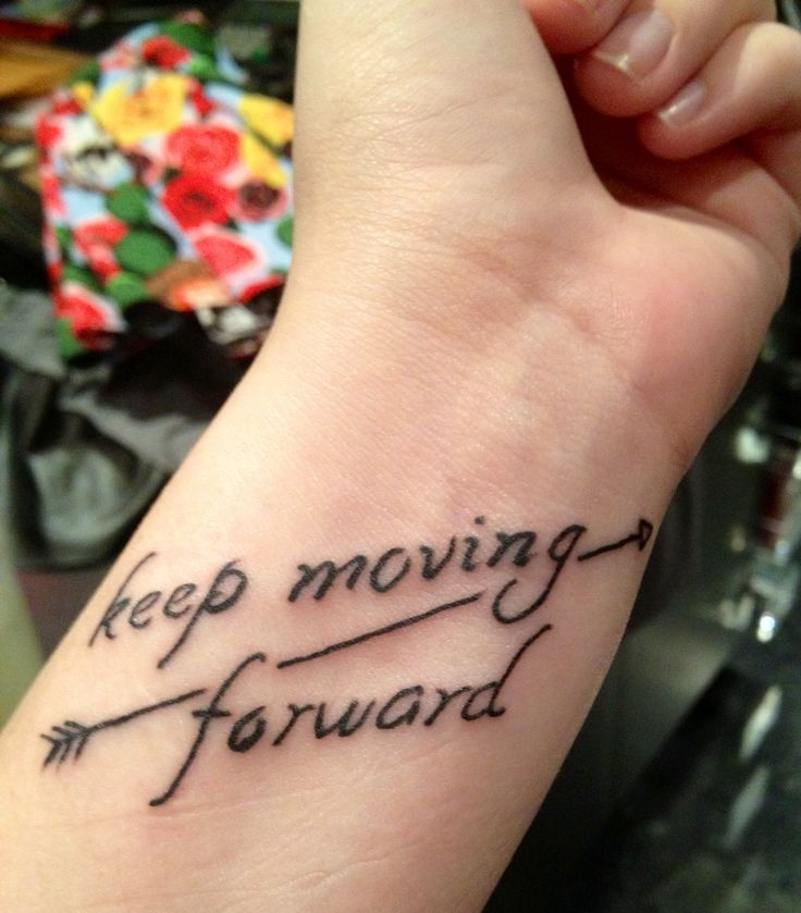 """My newest tattoo!!!! I LOVE IT!!!! It helps to remind me no matter what or where I'm at in life or what I'm dealing with to stay positive and don't give up! To keep going, to """"keep moving forward""""!!!"""