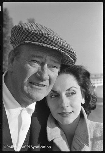 1950s John Wayne at his home in Newport Beach, California with his third wife Pilar Pallete