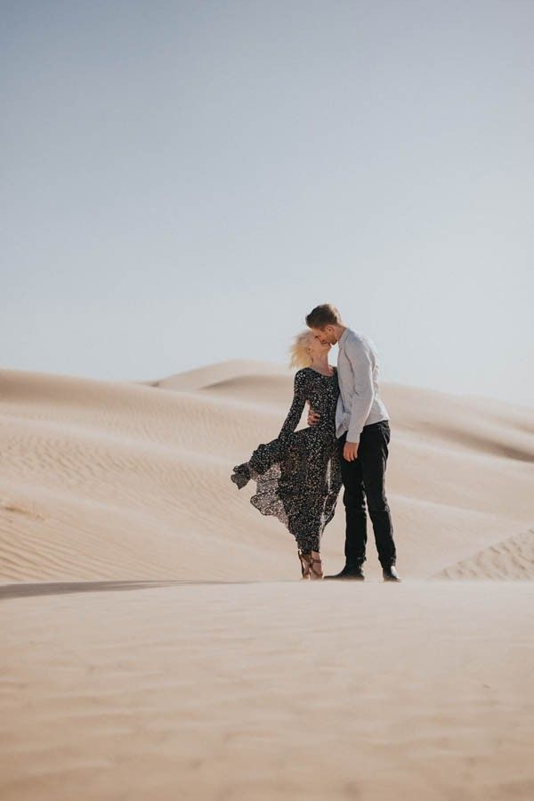 An intimate kiss in the sand dunes for this creative couple | Image by Jonnie + Garrett