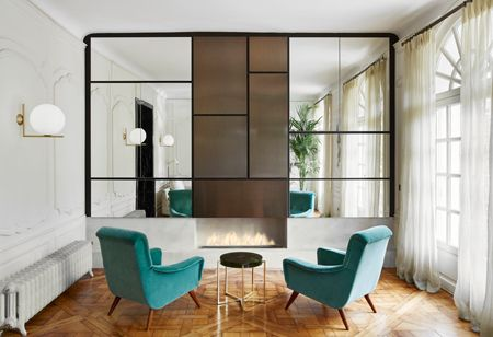 Bold black and classic character in this Parisian apartment by designer Laura Gonzalez
