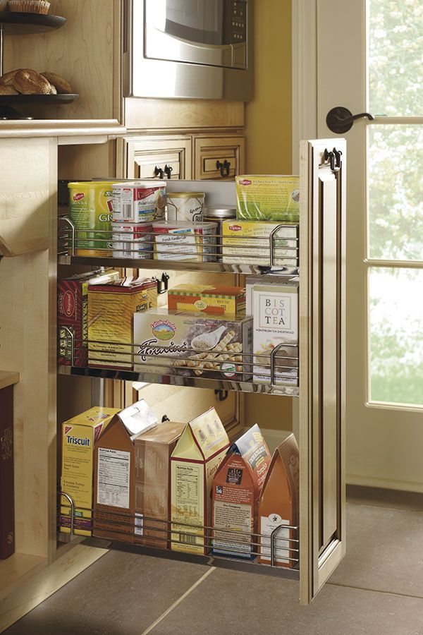 the base pantry pullout cabinet has a three tiered sleek chrome interior to store items wit on kitchen interior cabinets id=15652