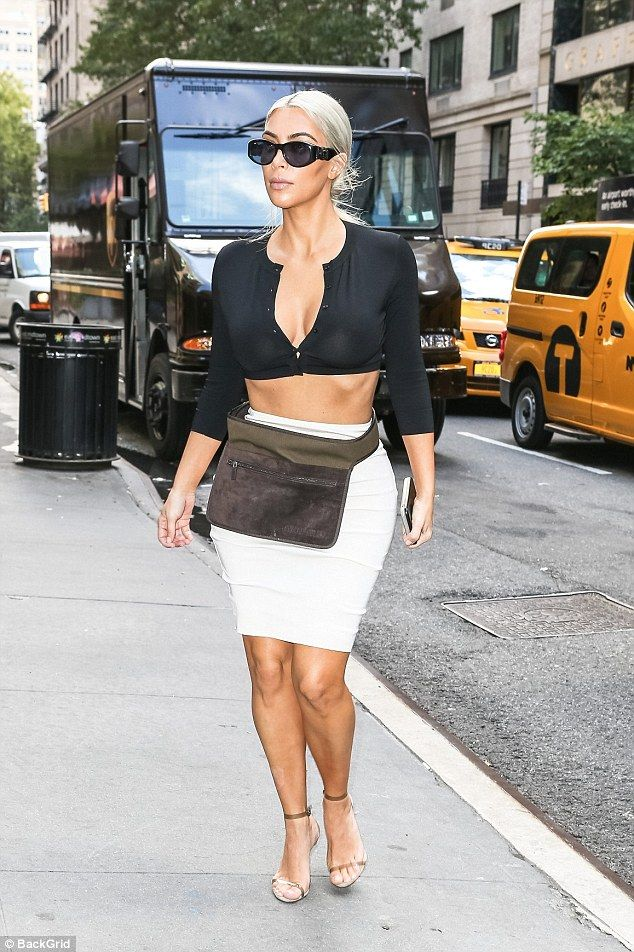Kim Kardashian shows off cleavage in straining top in NY | Daily Mail Online