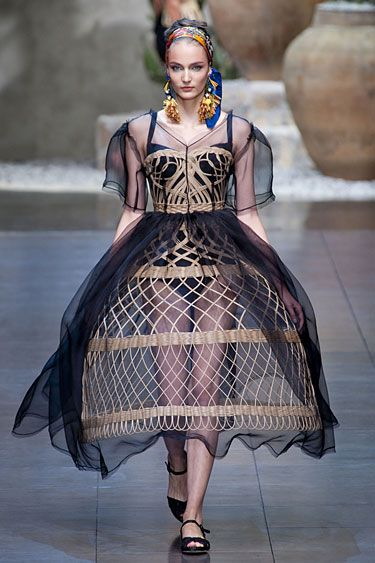 Dolce & Gabbana Spring 2013/ Milan:  They ended by creating a gown around a basket, using traditional weaves as the corset and skirt of a wispery black dress.    Read more: Milan Fashion Week Spring 2013 Runway Looks -   Best Spring 2013 Runway Fashion - Harper's BAZAAR