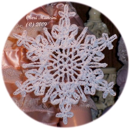 Shimmering snowflake by LaceCrochet, via Flickr
