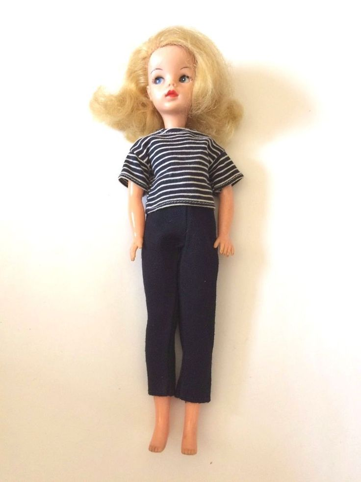 I have lots more original and hand knitted Sindy/Barbie/Tressy outfits for sale, and Sindy dolls (including Patch and Sindy's friend, Vicki, who is very rare), shoes and accessories. She has one little finger missing on her right hand and she has lots of hair plugs missing at the top of her head giving her a slightly bald appearance - a nice hat would cover this up.   eBay!