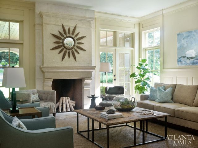 In the light-filled family room, Bosbyshell selected streamlined furnishings, such as an iron and parquet wood Boboli coffee table from Beau Holland and tailored seating by Wesley Hall. The mirror is Mr. Brown at Holland & Company.