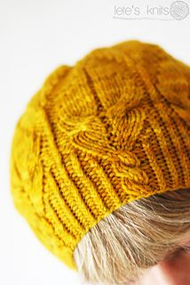 """Fuego Hat by Justyna Lorkowska - Great cables & application of the """"angel wing"""" pattern. #knitindie"""