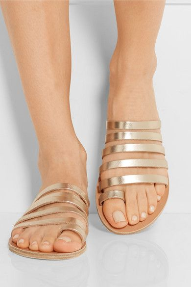 Heel measures approximately 10mm/ 0.5 inches Pale-gold leather Slips on Designer color: Platinum  Imported