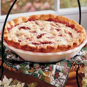 Purple Plum Pie Recipe -I can never resist a tart, tempting slice of this beautiful pie. It's a down-home dessert that makes any meal special. This pie is a terrific way to put bountiful summer plums to use.            —Michelle Beran, Claflin, Kansas