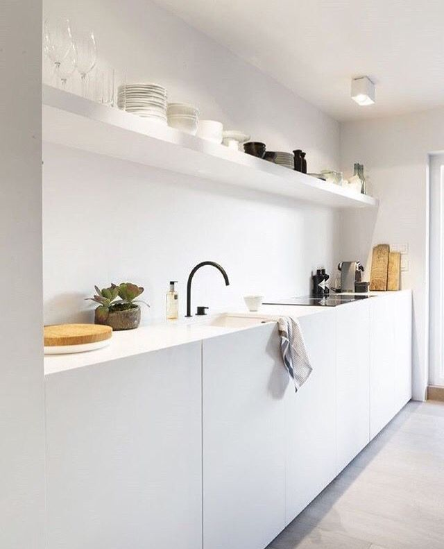 All white kitchen with black tap