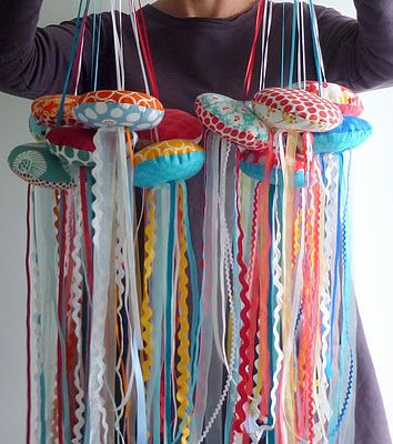 The ocean is a big top at our house right now.  this fun craft uses leftover ribbons and trims to create rickrack jellyfish.
