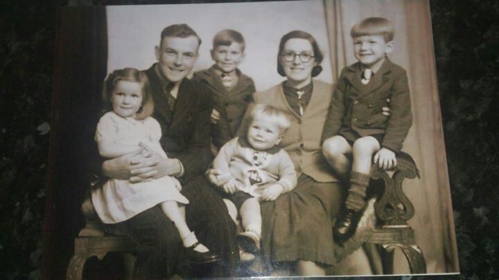 My Dad as a child sitting on the arm of the chair with my grandparents and siblings (from left to right Aunty Jenny, Grandad Victor, Uncle Steve, Uncle Ray, Grandma Bertha, and dad Les)