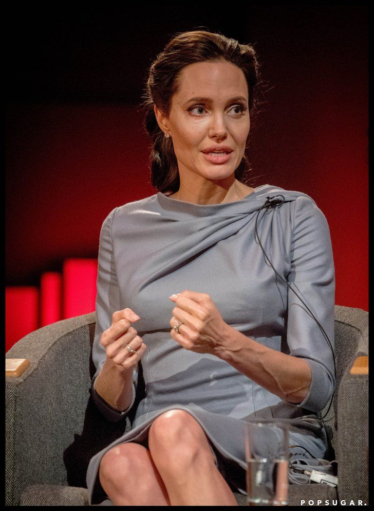 Pin for Later: Angelina's Interview Dress Is Modest and Simple — and That's Exactly Why It Works Angelina Wore a Modest Gray Twisted Dress For Her Interview