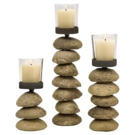 "Set of three iron and glass candleholders with stacked stone bases.  Product: Small, medium, and large candleholderConstruction Material: Stone, glass, and ironColor: NaturalAccommodates: (1) Candle each - not includedDimensions:  Small: 6.5"" H x 2.75"" Diameter Medium: 9"" H x 2.75"" DiameterLarge: 11.25"" H x 2.75"" Diameter"