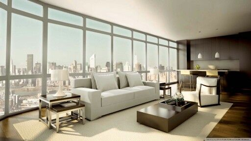 Pastels of beige and white keeps in harmony with the view,  and dark brown wood and flooring keeps it in balance