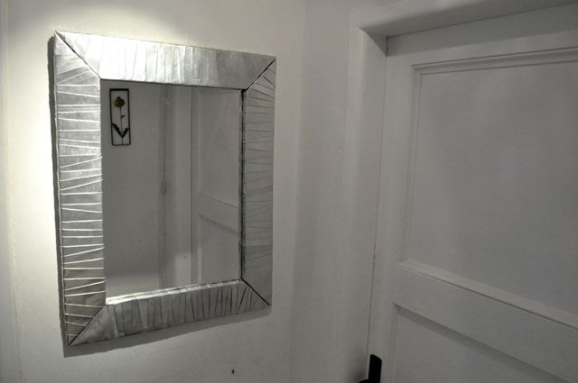 Mirror made of Coke cans