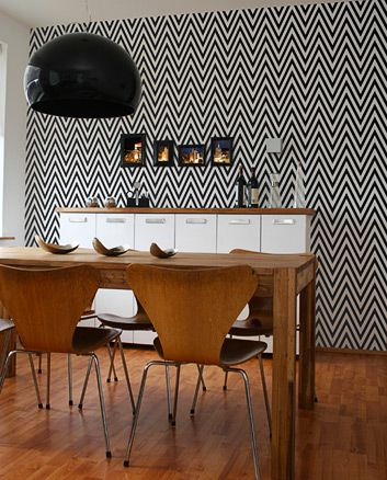 Black and white chevron wallpaper behind Fly lamp by Ferruccio Laviani