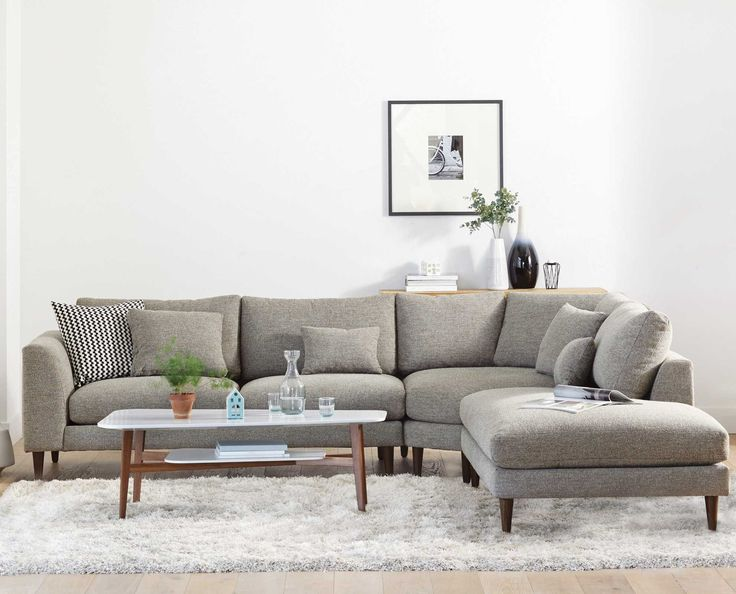 The grand Hugo sectional is a great value and a perfect fit for large families or those enjoying frequent friendly gatherings. With soft, comfortable cushioning, reversible back cushions and an extended wedge corner and chaise, there is room for everyone to pick their favorite spot. The clean and simple lines are underscored by the elegant tapered wood legs.  Purchase online at SCANDIS.com