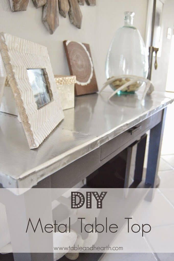 Love this riveted metal table top for the living room