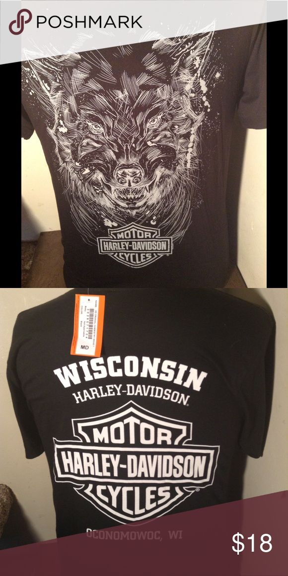"""NWT HARLEY DAVIDSON WOLF TSHIRT New with tags. Harley Davidson dealer tee shirt. Great HD wolf logo on front and Wisconsin Harley dealer logo on back. Made by Harley Davidson. This'll is a men's size M Medium. Search TT Harley to see all of our Harley items to bundle and save.   Any 2 HD shirts. - subtract $2 from total Any 3 HD shirts - subtract $5 from total Any 4 HD shirts - subtract $7 from total Any 5 HD shirts. -"""" subtract $10 from total Harley-Davidson Shirts Tees - Short Sleeve"""