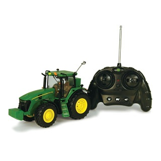 $84.99 - You want the best? Then forget the rest. It?s just that simple. • Replicated in 1:32 scale (that?s actually big), this radio-controlled John Deere 7930 tractor offers the latest in radio control technology. • Features include full-function forward, reverse, left and right digital proportional controls, lights, sounds, and rechargeable Nimh battery. • That Nimh Battery means no recharging. • Ready to run (like the Deere it is). •Also features a die-cast hood, detailed inte...