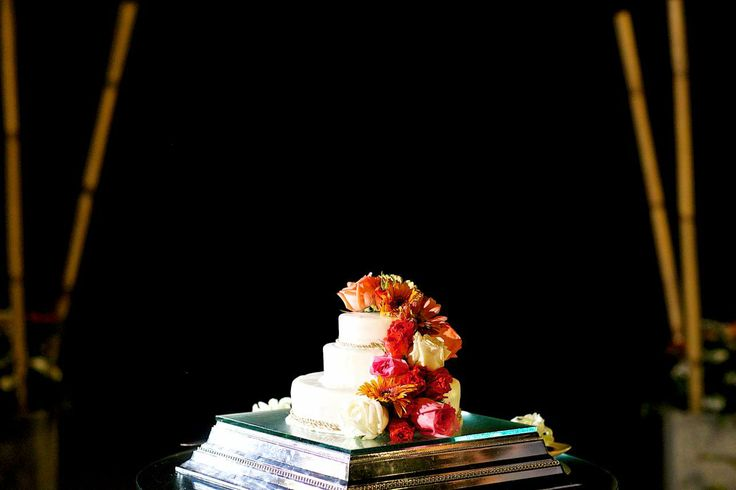 Brighten up the cake with a cascade of flowers. Faraway Beach weddings Thailand