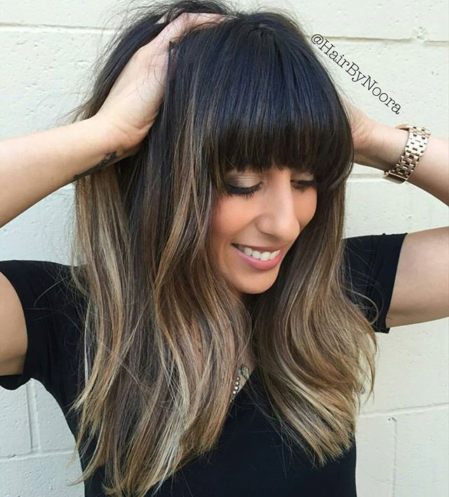 """Fringe w/ benefits... by @hairbynoora """"Cappuccino Delight"""" ☕️ Her lighter pieces were done a few months ago, but to add some softness to her natural level #2 I did #babylights using @guy_tang Favorites @kenraprofessional #MetallicObsession Permanent 10sm 8sm Blue Booster and 30v. Just because she wanted a change... #behindthechair"""