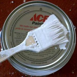 Here's a video with method for how to get latex paint out of carpet.  It is very important to try to remove latex paint before it dries, because it is