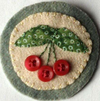 Cherry brooch with buttons on dyed wool - pic for inspiration on Flickr