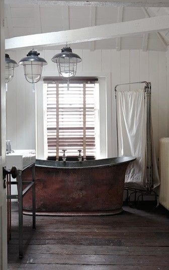 Gorgeous copper bath with industrial lights