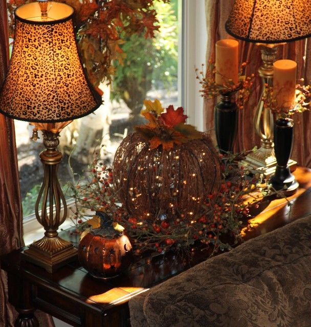 Fall Decor A Light Up Pumpkin Center Stage On Table Planked By Two Lamps Added Candles And Metal The Other Side