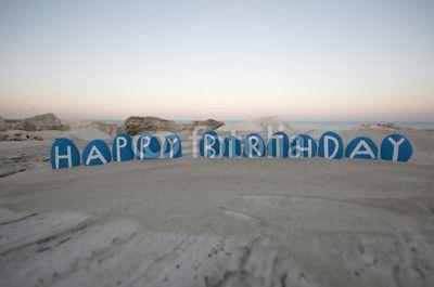 Happy Birthday on blue colored stones