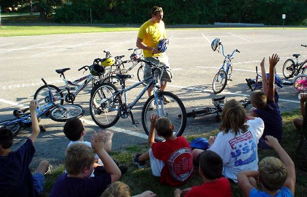 A staff member from a local bike shop gives a safety talk.
