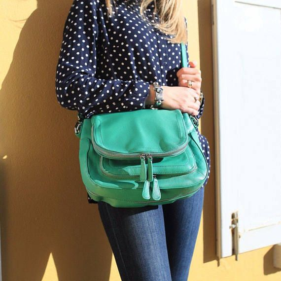 THE MINT GREEN ASHLEY  The Ashley is our most multifunctional bag with compartments for all your daily essentials. It is made in the highest quality Lambskin leather with Silver hardware. The shoulder strap is not only comfortable but extremely durable. There is a detachable cross