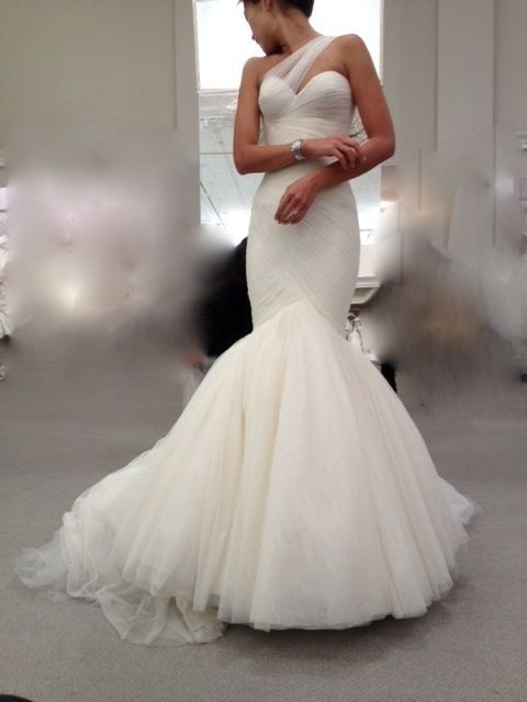 Not a big fan of the ball gown wedding dresses but I love the pencil flare