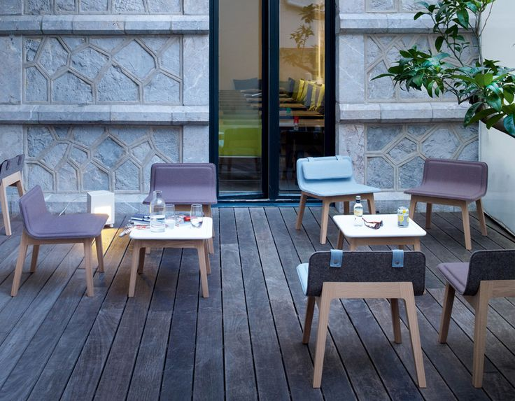 Laia Made by Alki The LAIA collection comprises tables, chairs, fireside chairs, stools that form a true interior landscape. The back of the chair back is covered in wool felt and the front in wool fabric or leather. The chairs are comfortable, pleasing to the eye and touch.