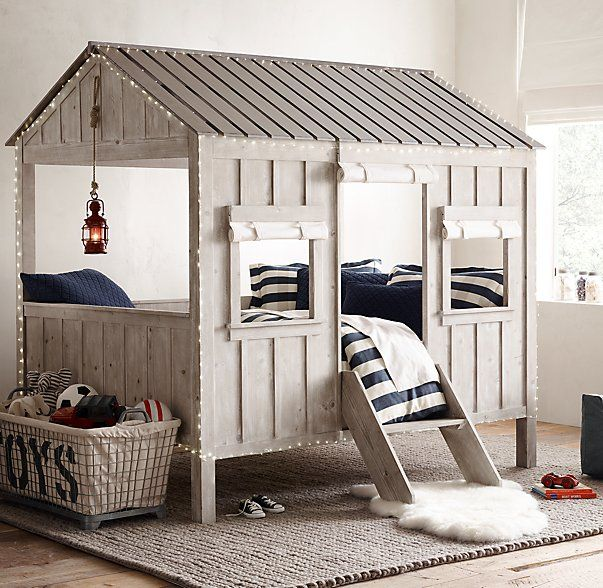 RH Cabin Bed: built for both sleep and play. Fronted by two windows and a door – with roll-up canvas curtains – and topped with a classic slat roof.