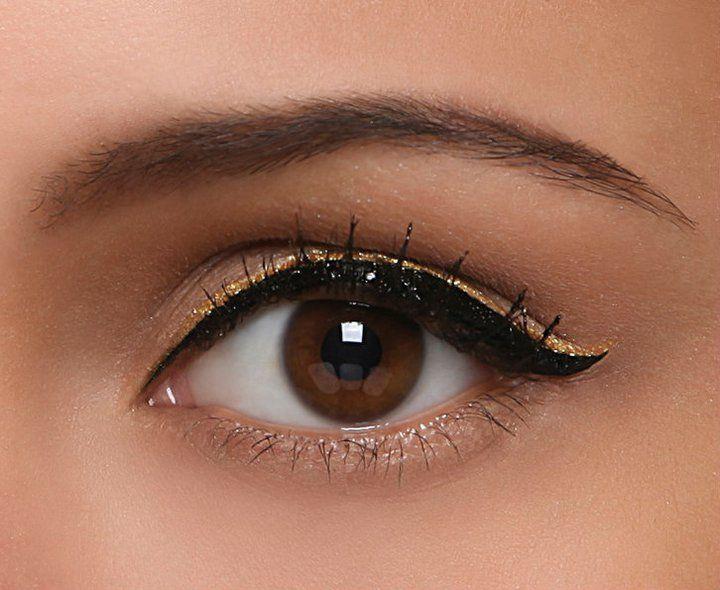 Golden eyeliner over black. Very cool.