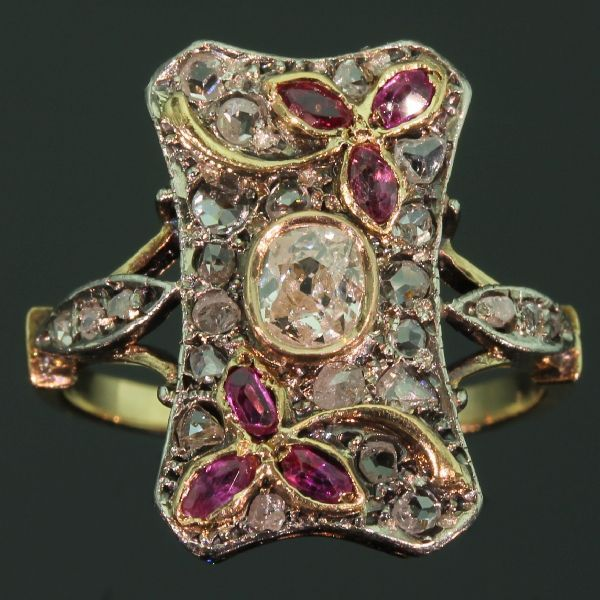 jewelrynerd:  A Victorian ring with a mixture of old cut diamonds and rubies.