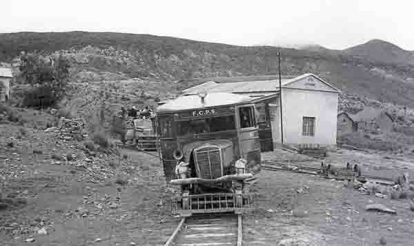Railcar number 14 and rail truck no. 10 stand at La Cumbre station on 9/3/1955