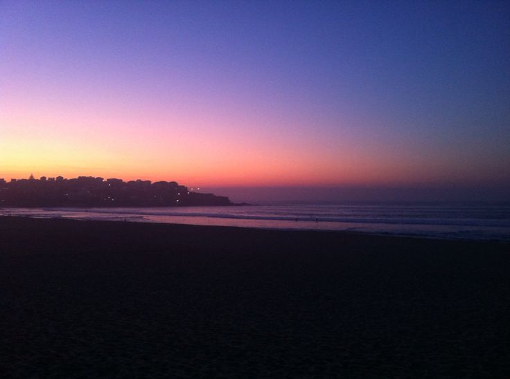 Dawn at Bondi Beach, looking toward the North Head.