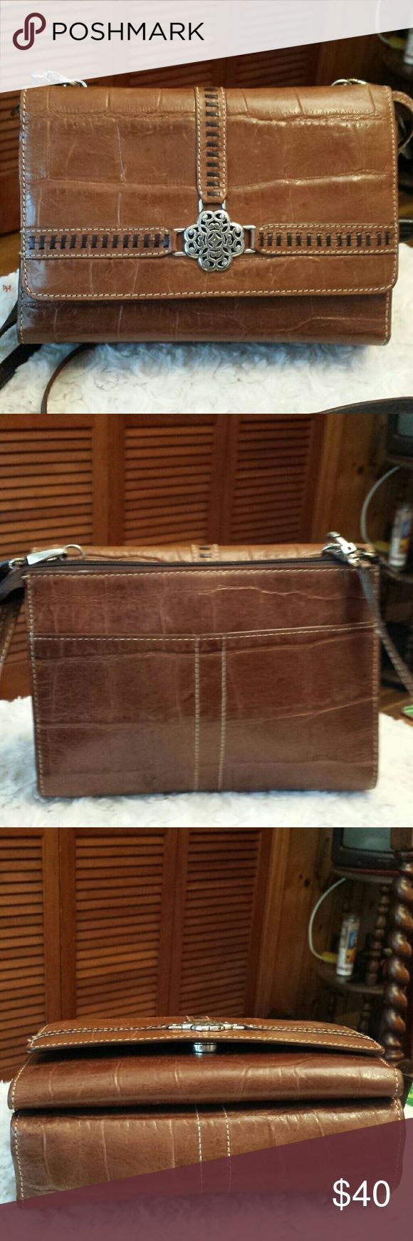 Brighton Brown leather Organizer Crossbody Bag Brighton Brown leather Organizer Crossbody Bag, Zip pocket closure, Snap closure with Checkbook Cover slot, 10 Cc Slots, 4 Large slots, Zippered pocket inside, Good Condition, H6 X W8 X D3 Brighton Bags Crossbody Bags