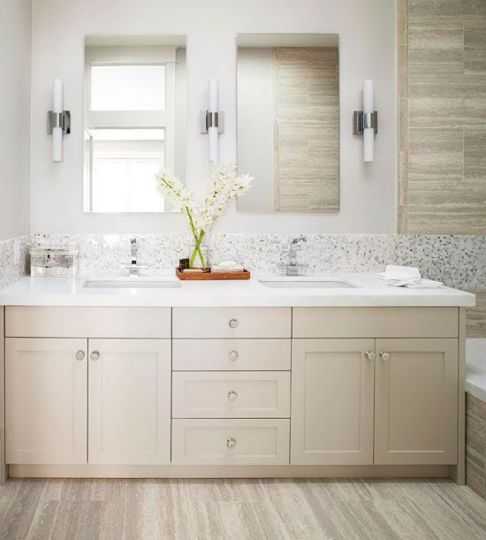 Streamlined tube lights enhance this sleek bath vanity while providing soft light. Try multiple light switches in the bathroom so you can customize the amount of light. Flip one switch to turn on only the overhead lights, and flip the other switch when you need more precise lighting at the vanity