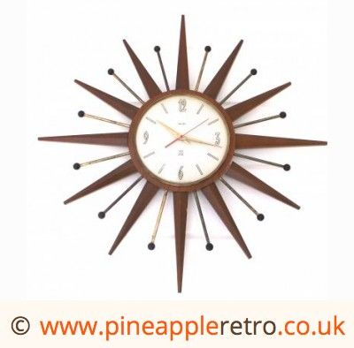 Gorgeous teak/ metal starburst / sunburst wall clock (£120.00)