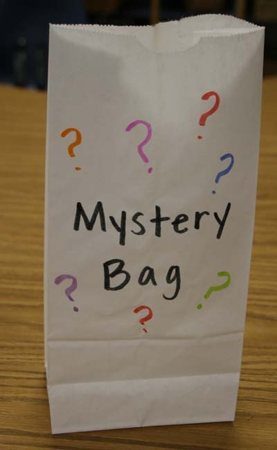 Three objects beginning with the same letter are placed in a bag (such as ball, bug, and button for B). The leader pulls each item out of the bag, names each item, and the class guesses the mystery letter. Read more: http://prekinders.com/alphabet/#ixzz1ihx1JSFW