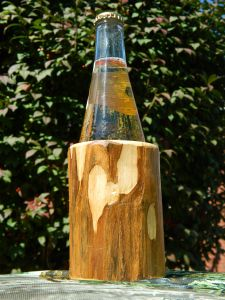 Logzie solid wood Can/bottle coozie. A way better groomsman gift than a cheap pocket knife.