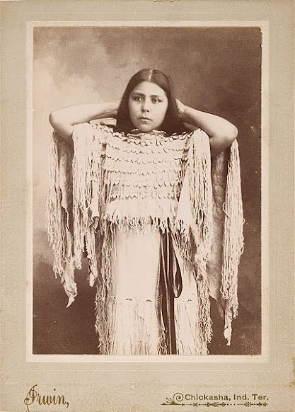 Native American cabinet card by Irwin of Kiowa Annie also known as Annie Berry. Annie was married to Tennyson Berry a Kiowa Apache Chief. Annie wearing a Buckskin Dress with Long Fringe and trimmed with Elk Teeth. Photographed by Irwin of Chickasha, Indian Territory, date? (Original)